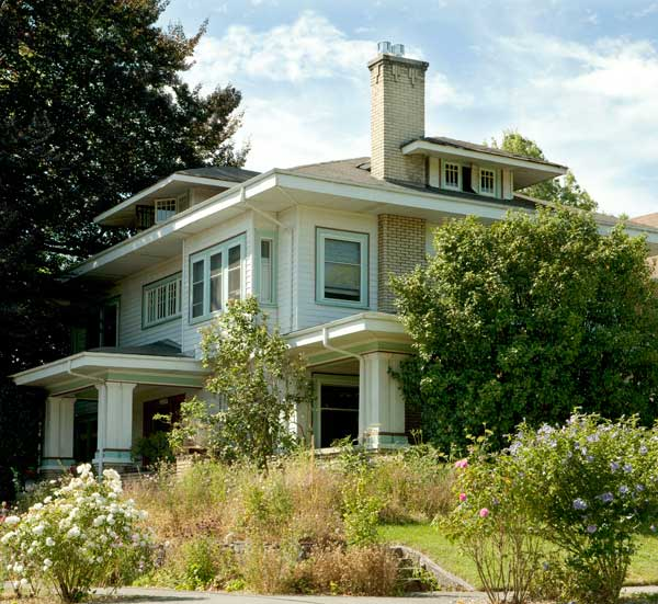 The 1912 house has Prairie-style elements; Julia Hanfling's mother chose the exterior colors when she owned the house.
