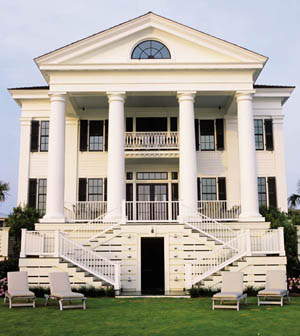 The 20' columns and classical façade of Chadsworth Cottage make it a Figure Eight Island landmark.