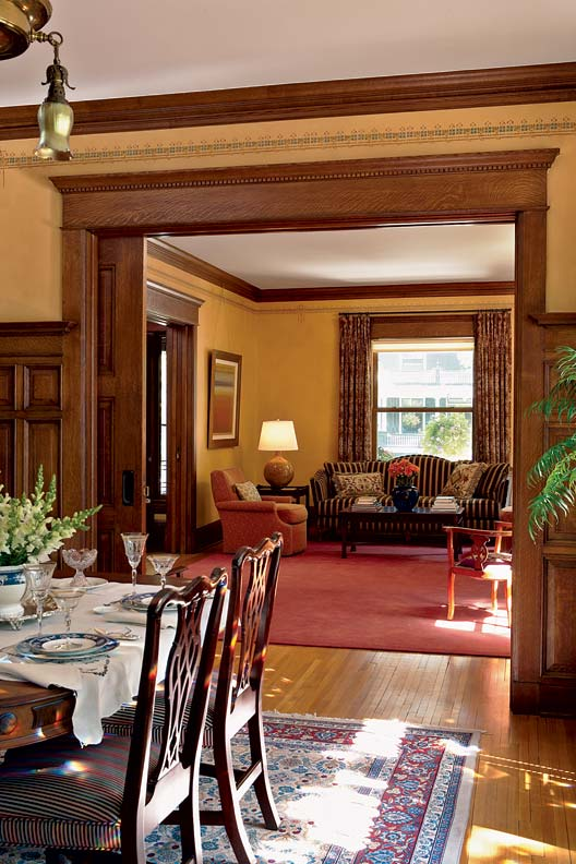 The absence of the pocket doors between the living and dining rooms was another detail that was discovered and replaced during the restoration process.