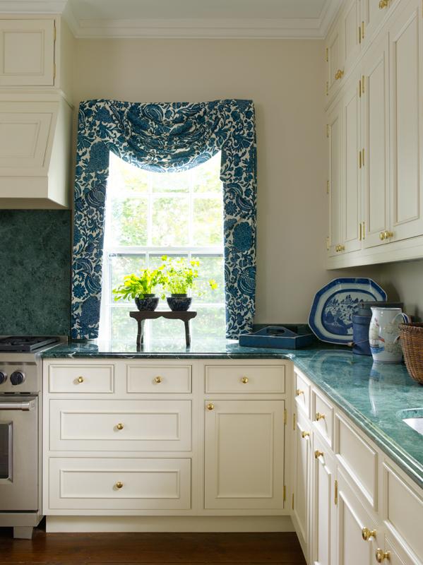 The antique porcelain platter in the corner inspired the kitchen design.