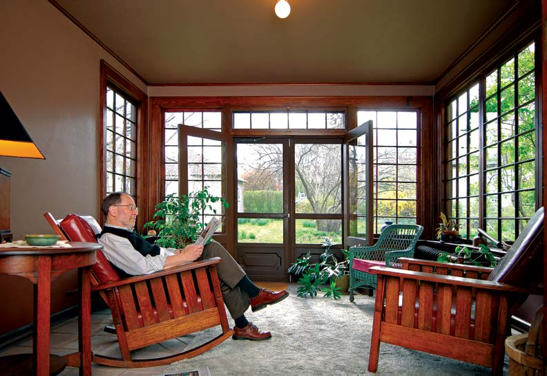 The author reglazed the sun porch windows—all 151 panes—during his first summer in the house.