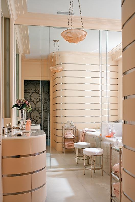 The bathroom takes on a 1930s Art Deco flair.