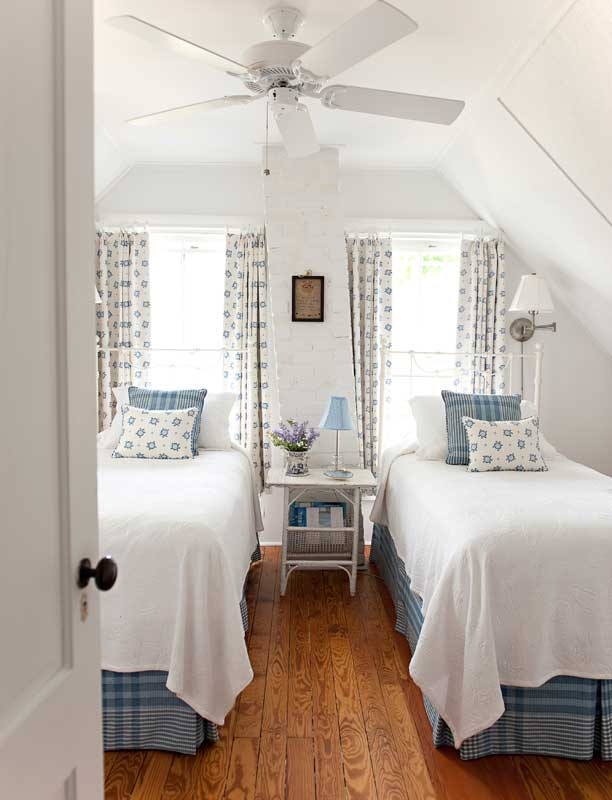 The bedrooms feature light summer tints set off against crisp white. Cotton and linen complement cottage furniture in rooms furnished with lighthearted antiques and paintings with seashore motifs.