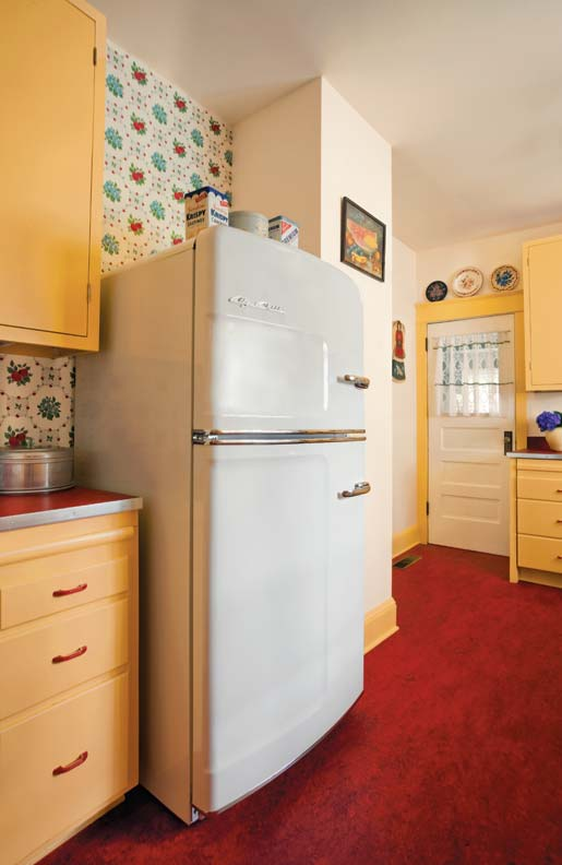 The Big Chill refrigerator, tucked into an alcove but not built in, adds to the retro look.