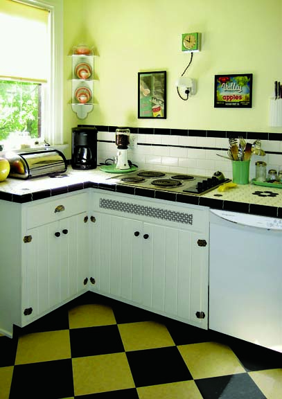 The black and cream color scheme for this Tudor kitchen floor was inspired by the movie You've Got Mail.