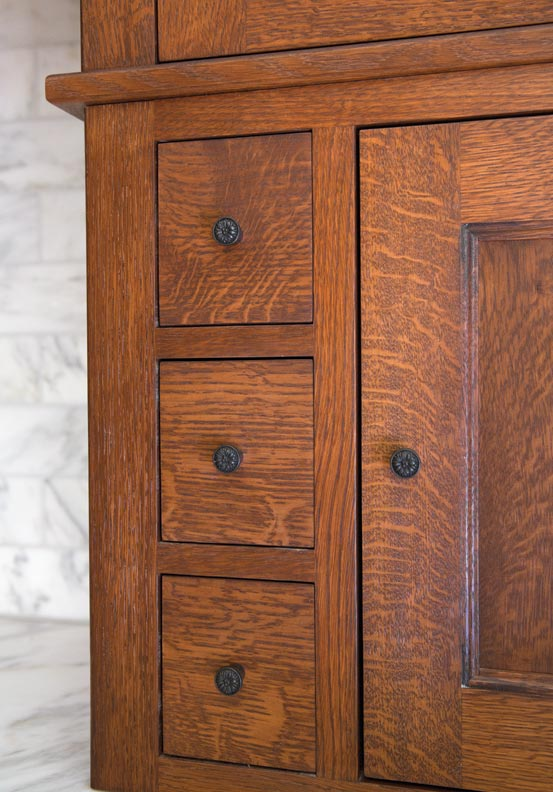 The cabinetry is made of oak.