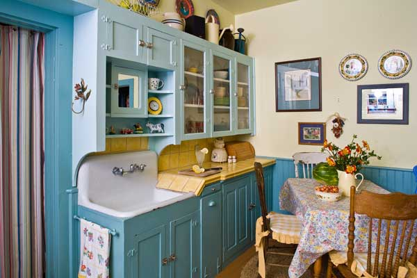 The cabinets and sink date back to a remodel, probably undertaken in the 1930s. The wainscoting is original; the owners stripped and restored it.