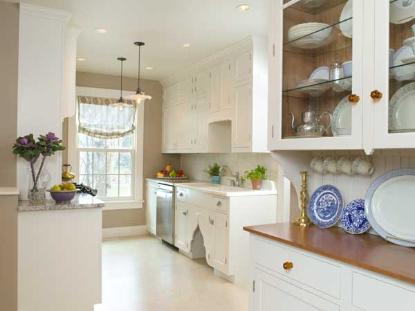The cabinets look like they survive from a ca. 1910 kitchen, but the only vintage item here is the porcelain sink with drainboards.
