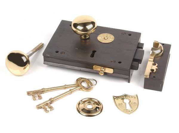 The 'Carpenters Rim Lock' from Van Dyke's Restorers, in black and brass.