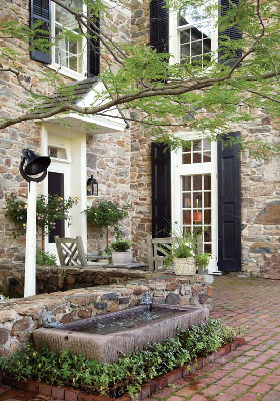 The charming entrance is one of many inviting details.