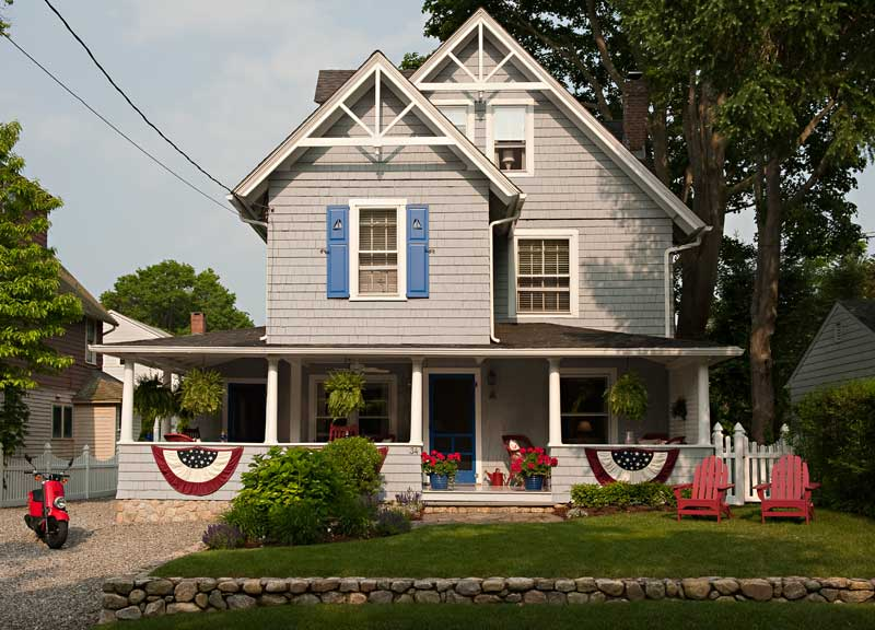 The Connecticut house wears Benjamin Moore's warm 'Shadow Gray' accented with 'Evening Blue' on the front door.