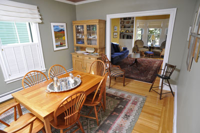 "The dining room features a restored hardwood floor of 2 1/4"" flat-sawn, face-nailed oak; new double-hung wood windows; and freshly painted walls and trim."
