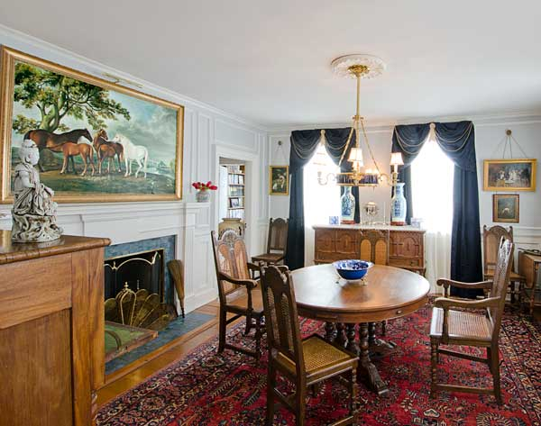 The dining-room furniture came with the house, as did the horse painting; the former owners bred Morgans.