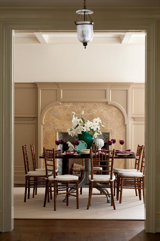 The dining room has an English-inspired firebox with a pink limestone surround.