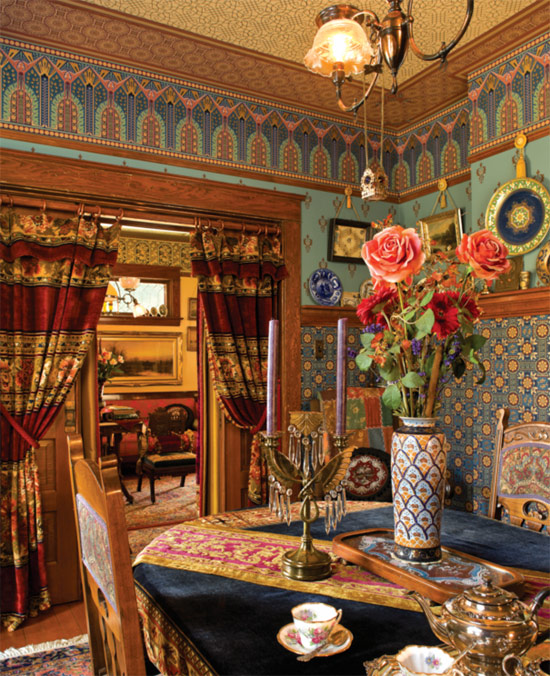 The dining room is a testament to the beauty of skillful wallpaper pattern mixing. The 'Victory Frieze' is above 'Roland Wall' with 'Bachelor Button' in the high dado. The fixture is a gaslight chandelier converted to electricity.