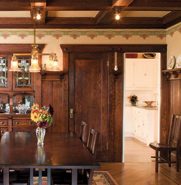 The dining room is similarly well-endowed, with wainscot and plate rail and box-beam ceiling of Douglas fir.