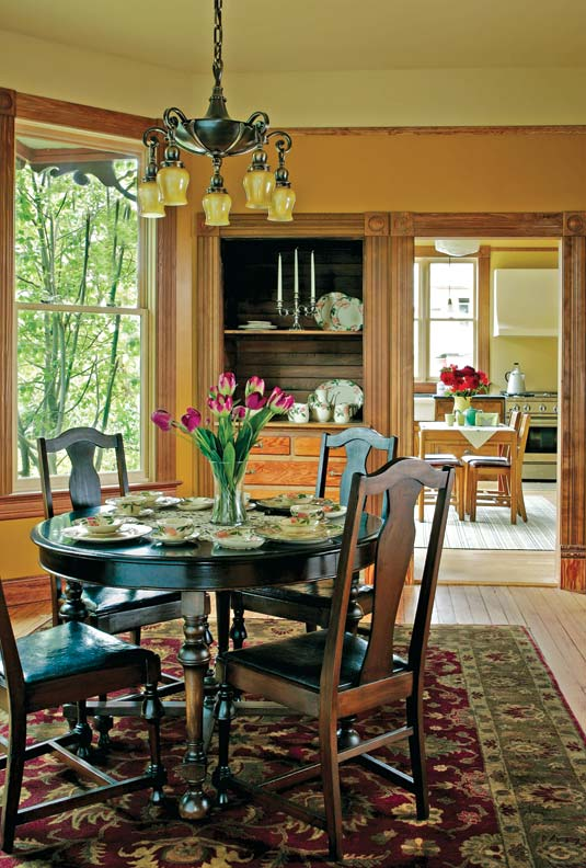 The dining room millwork was pieced together from original moldings salvaged throughout the house.