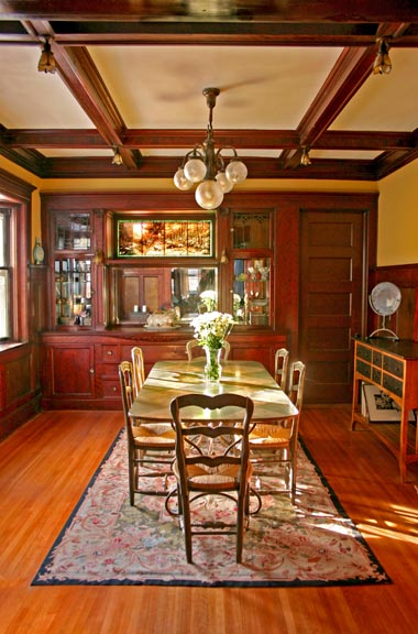 The dining room's built-in, glass-topped original buffet became the inspiration for a new cabinet in the family room.