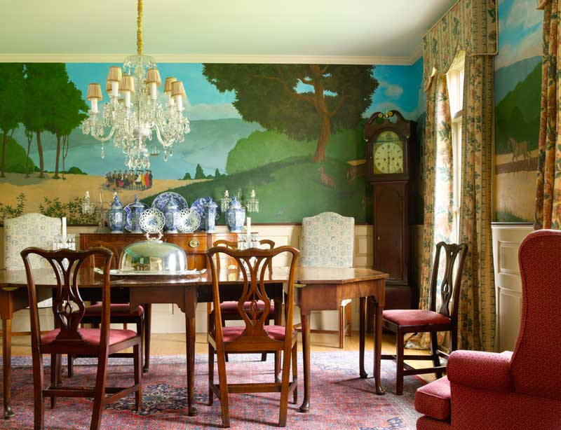 The dining room's colorful mural is a highlight of the otherwise neutral interior.
