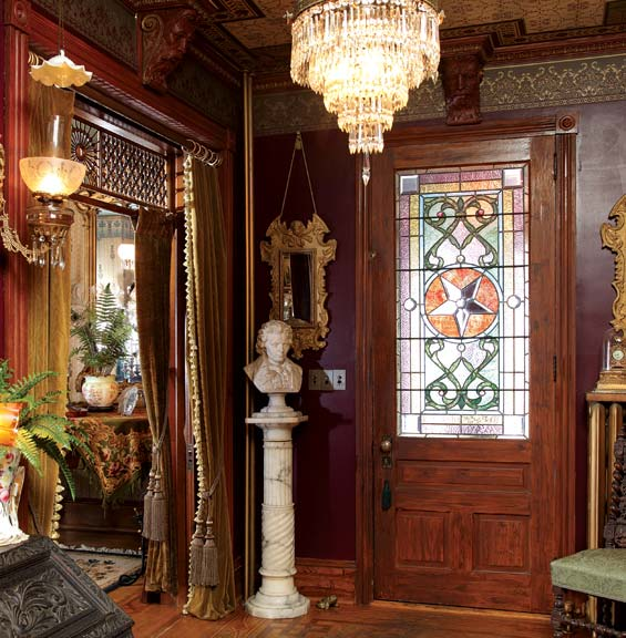 The entry is done in full Victorian finery; Jim had to buy back the stained-glass panel in the front door.