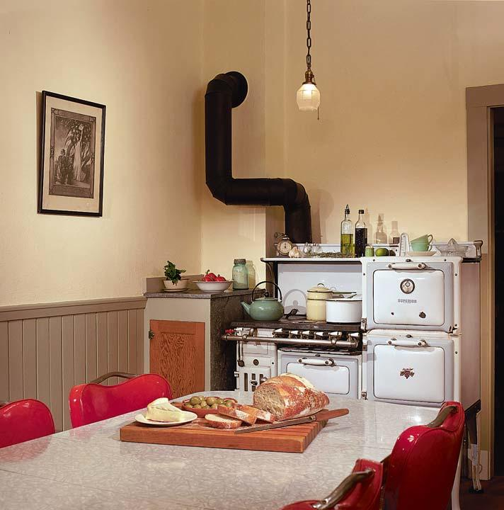 The existing kitchen stove, ca. 1920, was restored, and the 1940s kitchen table left in place.