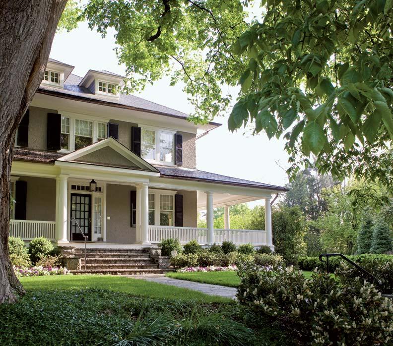 The exterior of the house features original pebbledash stucco.