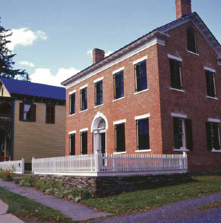 The Federal facade probably dates to 1832; the building next door is the 1888 rebuilding of the general store that is part of the property.