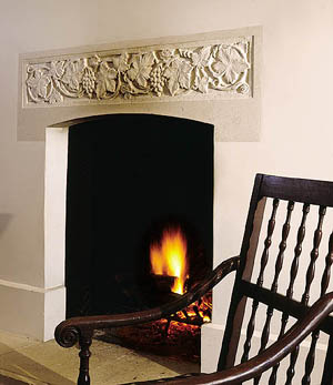 Interior walls are finished in painted boards, reminiscent of the interior partitions of Sunday houses. The fireplace, with its carved stone lintel, anchors the house both inside and out.