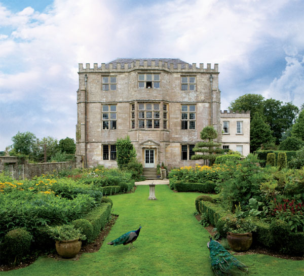 The four-story stone hunting lodge was built in 1550 in a classically symmetrical Elizabethanmanner. A walled garden added during the 1980s enhances the entrance.