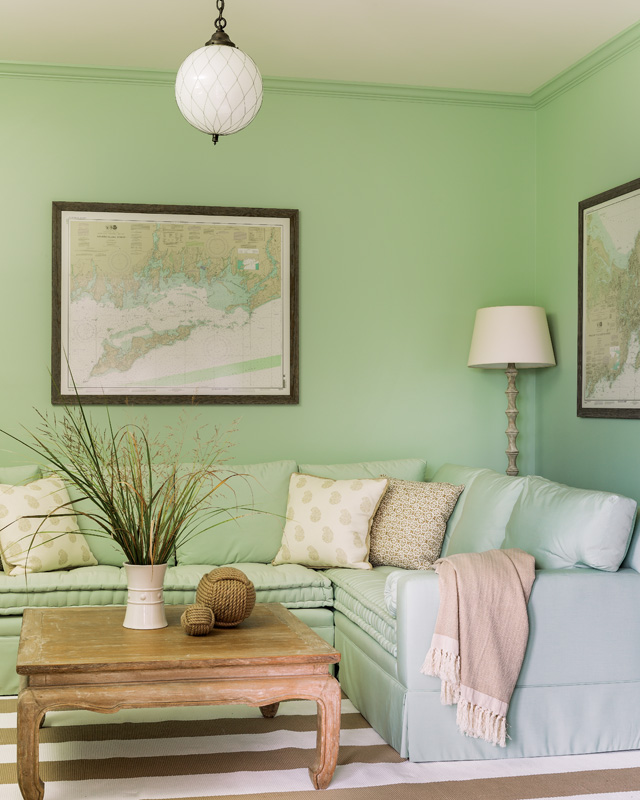The framed nautical charts give the room a beachy feel.