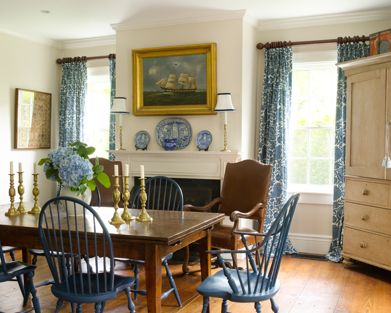 The generous space includes a hearthside dining area beyond the island.
