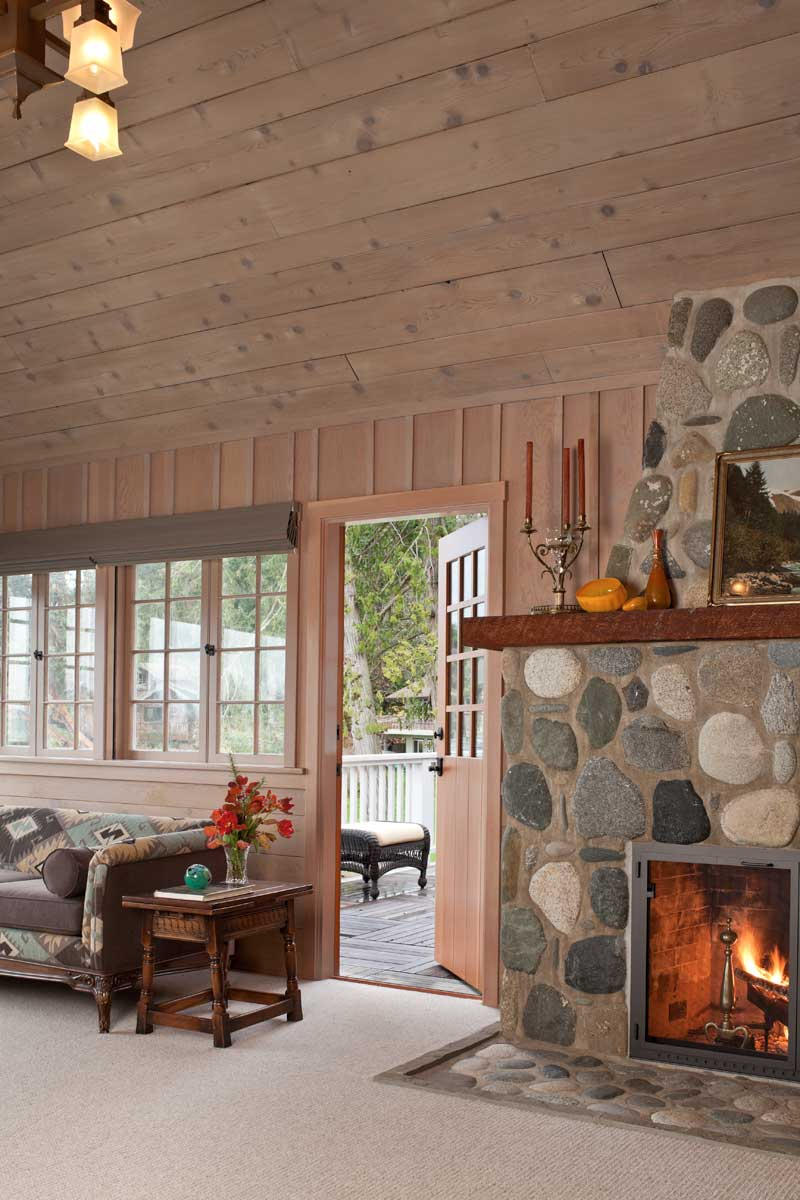 The great room has board-and-batten walls over a wainscot of horizontal boards.