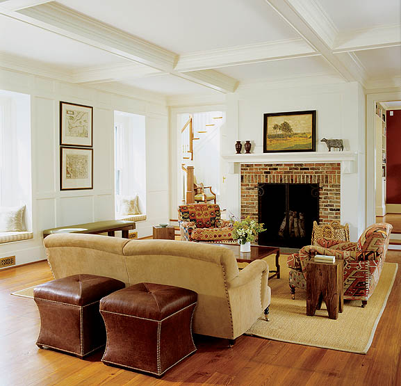 "A combination living room and dining room, the great room retains a cozy and approachable feel despite its large proportions. ""The coffered ceiling adds interest while bringing down the scale of the high ceiling,"" Decker says."