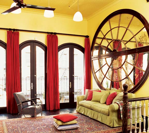The gutsy centerpiece of the living room is the 10'-diameter mirror from the Breakers Hotel in Palm Beach.