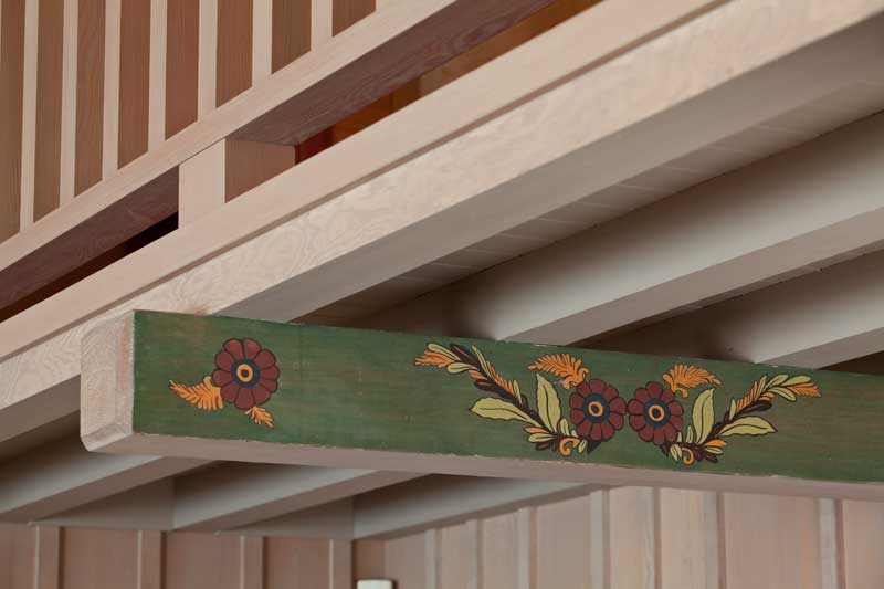 The hallway and rafters were embellished in the 1940s by a Norwegian-born artist.