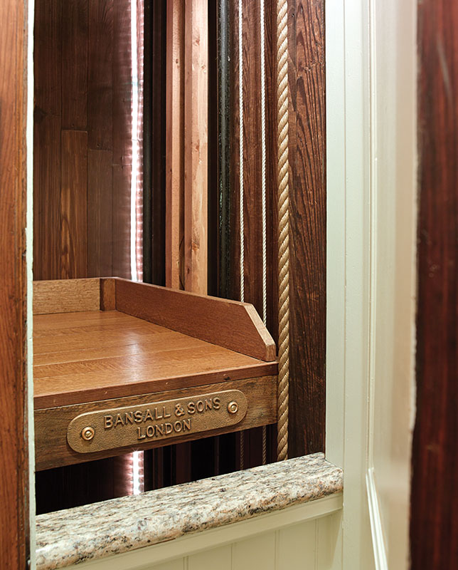 The homeowner and his son restored the existing dumbwaiter.