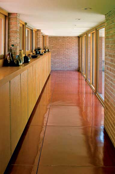 The home's distinctive red floors were replicated using a topcoat nearly identical to the original material.