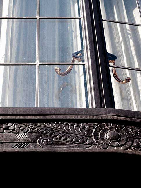 The home's distinctive three-story iron bay window was painstakingly restored.