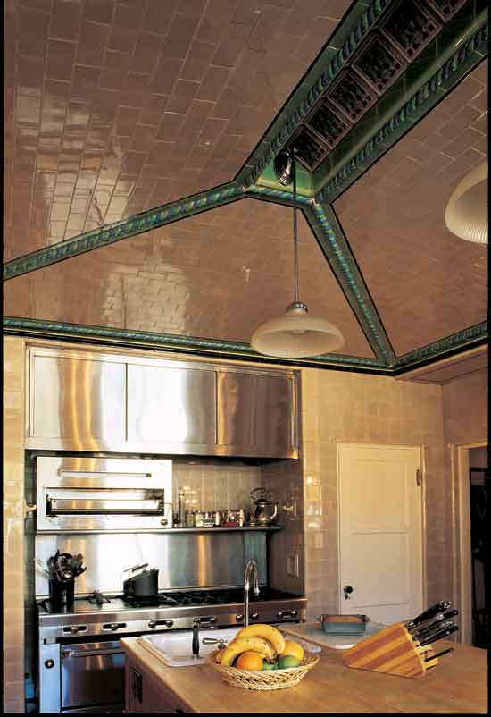 The kitchen in this 1926 Spanish Revival house got a floor-to-ceiling tile treatment. (Photo: Melba Levick)