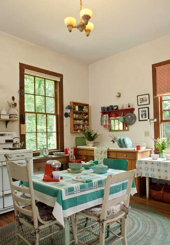 The kitchen is better described as evolved, rather than reproduction. Stove and sink are mid-20th-century.