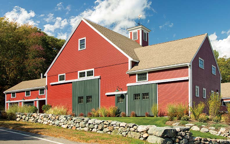 The large structure once functioned as a dairy barn.