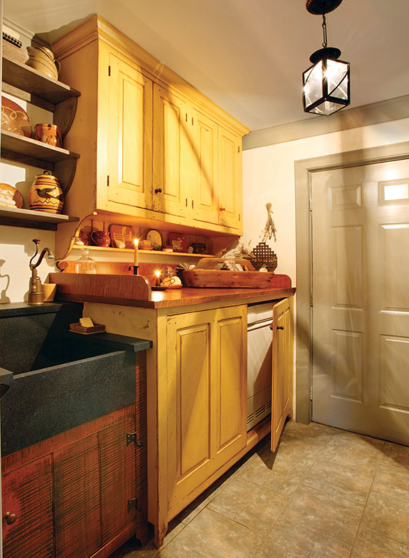 The laundry room echoes the design of the kitchen.