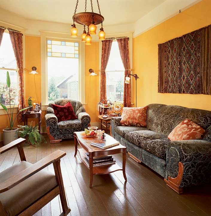 The living room is now a cheerful, historic yellow.