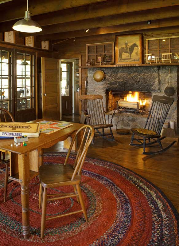 The main living room, with its massive stone fireplace, is the center of the original 1911 cottage.