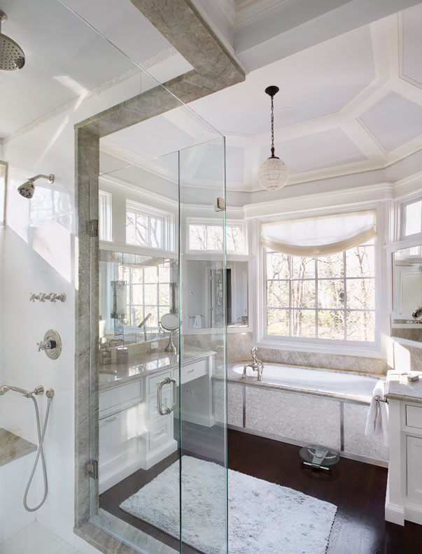 The master bath is finished in marble.