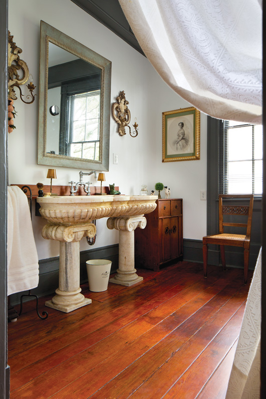 The master bathroom has a European antique double sink.