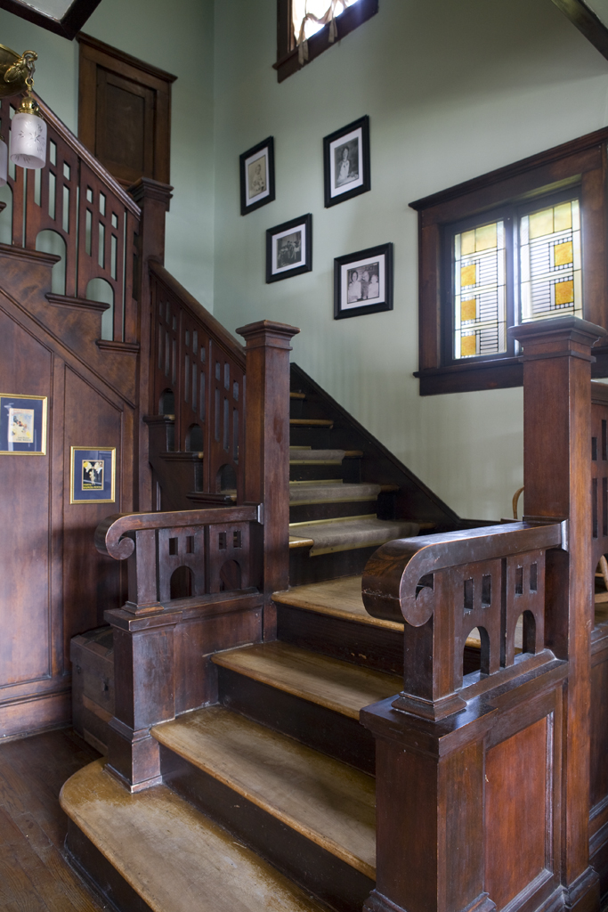 The McDaniels spent hours refurbishing the distinctive woodwork on the staircase, which is stamped with the name of the craftsman, William W. Martin.
