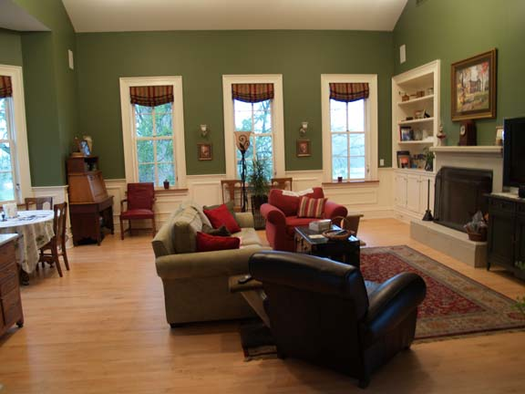 The new family room boasts many traditional architectural features, including windows and wainscoting, that perfectly match the home's originals. Most important, it offers plenty of space for Sam to maneuver around.