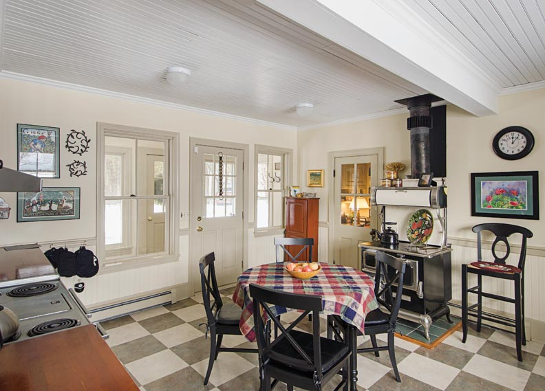 The new floor in this 1920s lakeside cottage is a floating laminate system laid over a substrate.