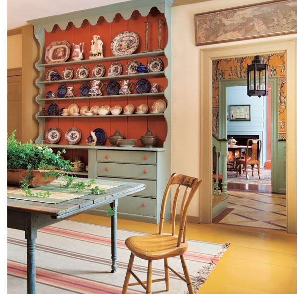 The old kitchen has an original cupboard painted in period colors.